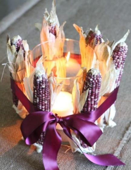 """<div class=""""caption-credit""""> Photo by: StyleCaster</div>We fell for the surprising magenta color used in this centerpiece. Natural Indian corn also comes in a variety of colors and is the perfect addition to a Thanksgiving table. <br> Image Via Shelterness"""