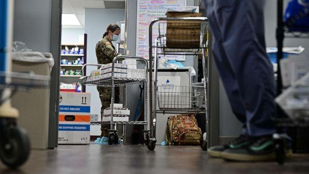 PHOTO: Sgt. Katrina Byrne of the Kentucky National Guard works as a pharmacy technician at St. Claire Regional Medical Center, Sept. 16, 2021, in Morehead, Kentucky.  (Jon Cherry/Getty Images)