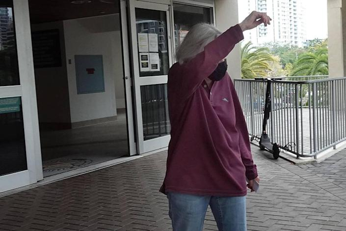 Broward Schools attorney Barbara Myrick hides her face as she is released from the Broward County main detention center in Fort Lauderdale on Wednesday, April 21, 2021.