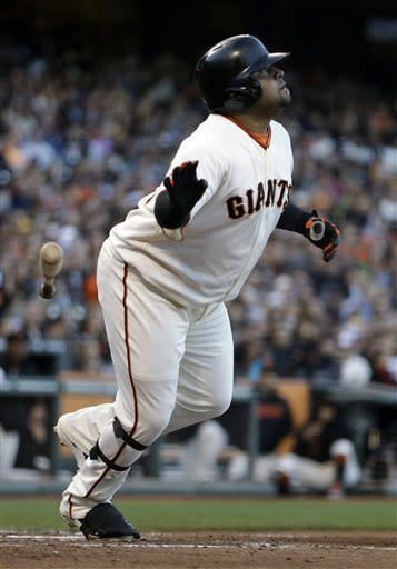 San Francisco Giants' Pablo Sandoval drops his bat as he watches his two-run home run hit off San Diego Padres' Andrew Cashner in the fourth inning of a baseball game on Saturday, April 20, 2013, in San Francisco. (AP Photo/Ben Margot)