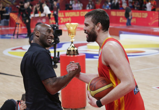 Basketball - FIBA World Cup - Final - Argentina v Spain - Wukesong Sport Arena, Beijing, China - September 15, 2019 Spain's Marc Gasol is congratulated by former basketballer Kobe Bryant after winning the FIBA World Cup REUTERS/Jason Lee