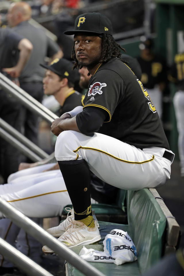 Pittsburgh Pirates' Josh Bell sits in the dugout during the fifth inning of the team's baseball game against the Milwaukee Brewers in Pittsburgh, Wednesday, Aug. 7, 2019. (AP Photo/Gene J. Puskar)