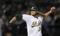 Oakland Athletics pitcher A.J. Puk works against the New York Yankees during the eighth inning of a baseball game Wednesday, Aug. 21, 2019, in Oakland, Calif. (AP Photo/Ben Margot)