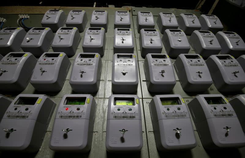 FILE PHOTO: Electric meters of an apartment building are seen in Barcelona