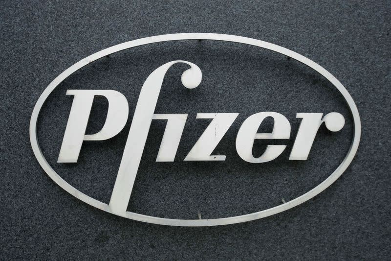 The Pfizer logo is seen at their UK commercial headquarters in Walton Oaks