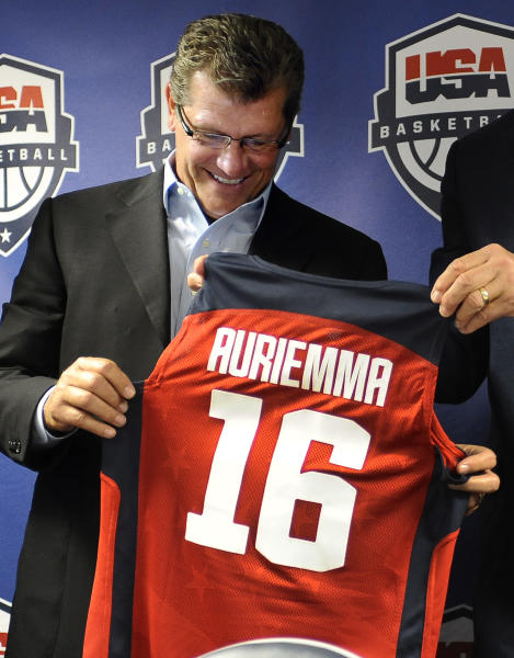 Connecticut head coach Geno Auriemma smiles after receiving a team jersey at a news conference announcing he will head the U.S. women's basketball team at the 2016 Rio de Janeiro Olympics, in Storrs, Conn., Friday, Sept. 6, 2013. (AP Photo/Jessica Hill)