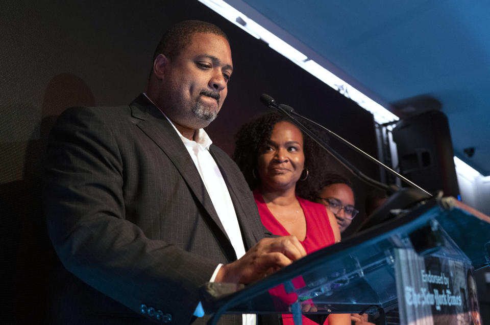 Alvin Bragg, a former top deputy to New York's attorney general, becomes emotional as he is joined by his family as he speaks to supporters in New York, late Tuesday, June 22, 2021. (AP Photo/Craig Ruttle)