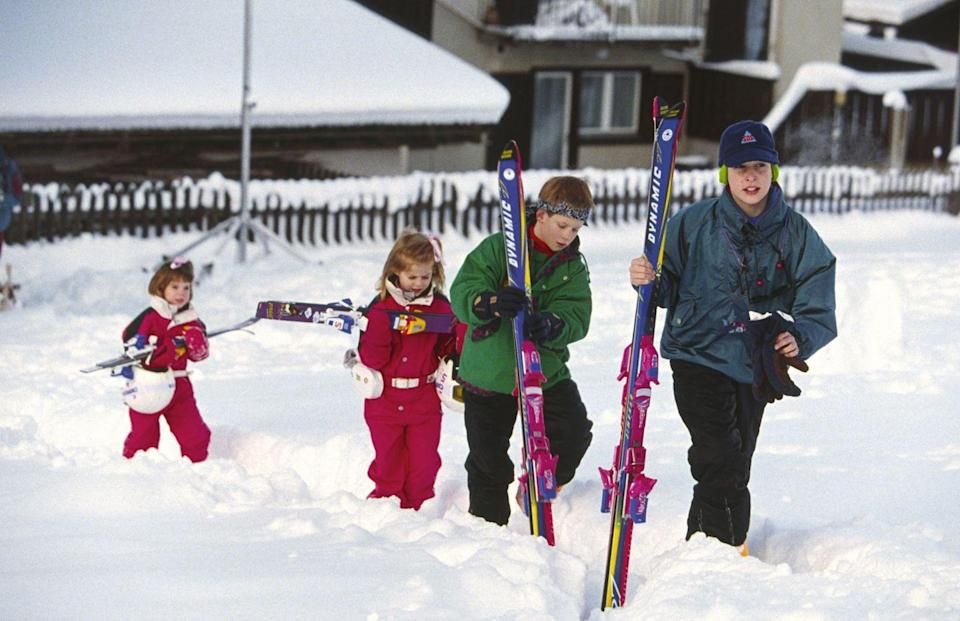 <p>The princesses trudge through the snow with their cousins Prince Harry and Prince William on vacation in Switzerland. </p>