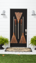 <p>Lean into the inevitable unexpected that the holiday brings by dressing your door with vintage broomsticks instead of a traditional Halloween wreath. It'll also align with your home's farmhouse-chic vibe. </p>