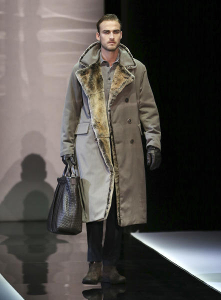 A model wears a creation for Giorgio Armani men's Fall-Winter 2013-14 collection, part of the Milan Fashion Week, unveiled in Milan, Italy, Tuesday, Jan. 15, 2013. (AP Photo/Antonio Calanni)