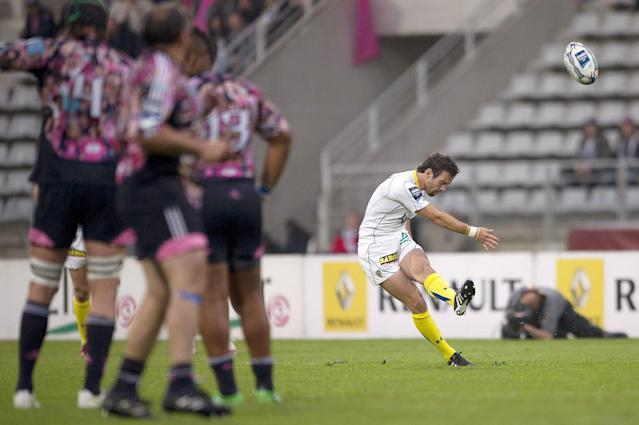 Clermont's scrum-half Morgan Parra kicks a penalty kick during the European Challenge Cup semi final rugby union match Stade Francais vs. Clermont at the Charlety stadium in Paris on April 29, 2011. AFP PHOTO / BERTRAND LANGLOIS (Photo credit should read BERTRAND LANGLOIS/AFP/Getty Images)