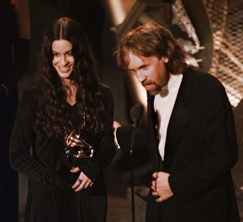 Alanis Morissette and record producer Glen Ballard accept the award for Album of the Year at the 38th annual Grammy Awards. (Photo: AP/Eric Draper)