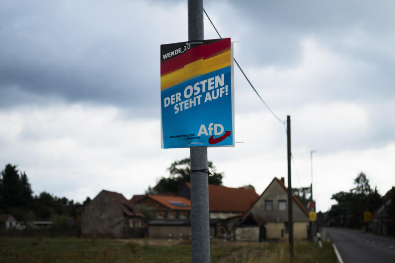 In this Friday, Aug. 16, 2019 photo an election campaign poster of German Alternative for Germany, AfD, party for the Saxony state election reading: 'The East stands up' is displayed in the village Gruenwald near Bautzen, Germany. Two elections in eastern Germany's states Brandenburg and Saxony on Sept. 1, 2019 look set to bring big gains for the far-right Alternative for Germany party and another blow to the traditional parties that form the national government. (AP Photo/Markus Schreiber)
