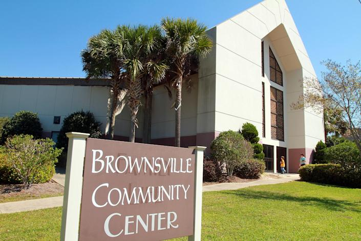 In this March 25, 2012, photo, Brownsville Assembly churchgoers enter the Brownsville Community Center in Pensacola, Fla. The church that was home to the largest Pentecostal outpouring in U.S. history is on the edge of financial ruin. The revival that drew some 5,500 people nightly at its height saddled the congregation with an $11.5 million debt that members were left to pay off after both the out-of-town throngs and former Rev. John Kilpatrick moved on. The red ink is mostly unknown outside the congregation. (AP Photo/John David Mercer)