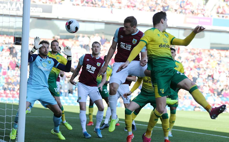 BURNLEY, ENGLAND - SEPTEMBER 21: Chris Wood of Burnley scores his teams first goal during the Premier League match between Burnley FC and Norwich City at Turf Moor on September 21, 2019 in Burnley, United Kingdom. (Photo by Nigel Roddis/Getty Images)