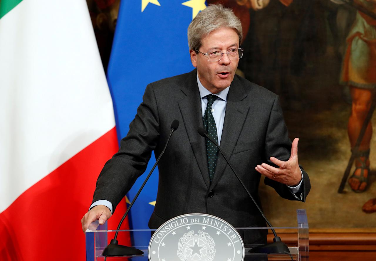Italian Prime Minister Paolo Gentiloni gestures during a news conference to present an agreement on research in alternative fuels and carbon-cutting technologies in Rome, Italy, November 21, 2017. REUTERS/Remo Casilli