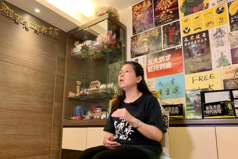 Office worker Daisy Lam speaks to Reuters at her living room in Hong Kong