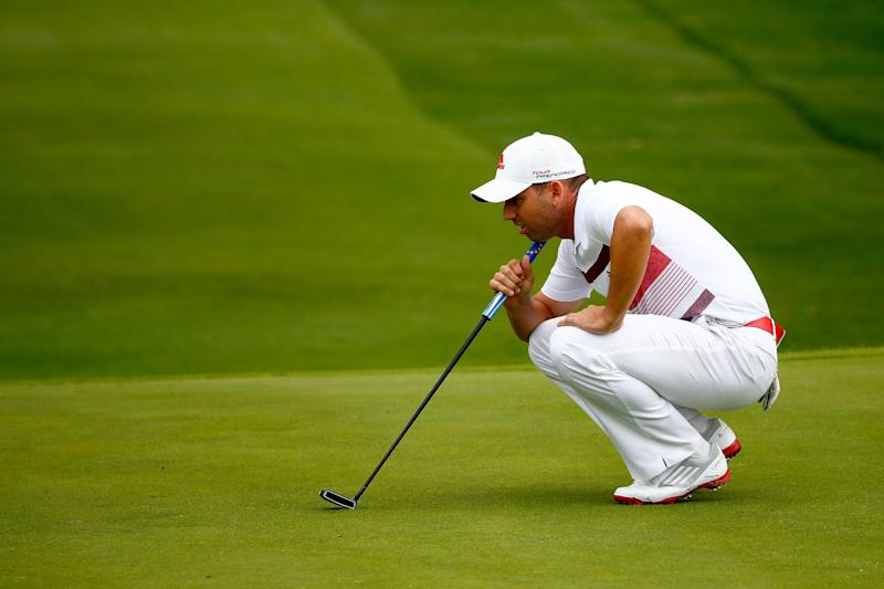 Sergio Garcia of Spain lines up a putt on the 18th green during the third round of the World Golf Championships-Bridgestone Invitational at Firestone Country Club South Course on August 2, 2014 in Akron, Ohio