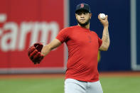 Boston Red Sox starting pitcher Eduardo Rodriguez warms up during the baseball team's practice Wednesday, Oct. 6, 2021, in St. Petersburg, Fla., for an AL Division Series matchup against the Tampa Bay Rays that starts Thursday. (AP Photo/Chris O'Meara)