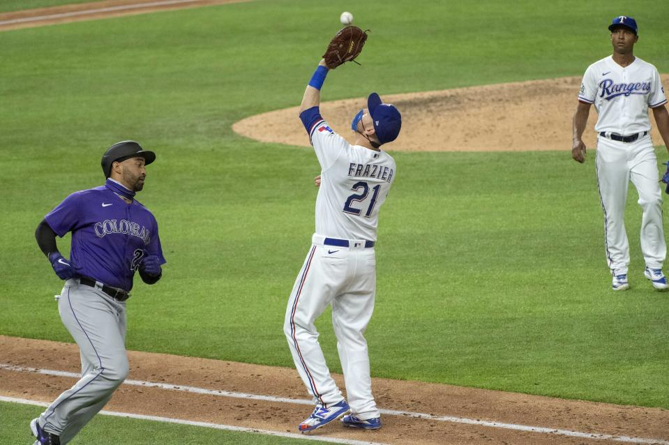 Texas Rangers first baseman Todd Frazier (21) makes the final out of an opening day baseball game on a popup by Colorado Rockies' Matt Kemp, left, as relief pitcher Jose Leclerc , right, looks on during the ninth inning Friday, July 24, 2020, in Arlington, Texas. (AP Photo/Jeffrey McWhorter)