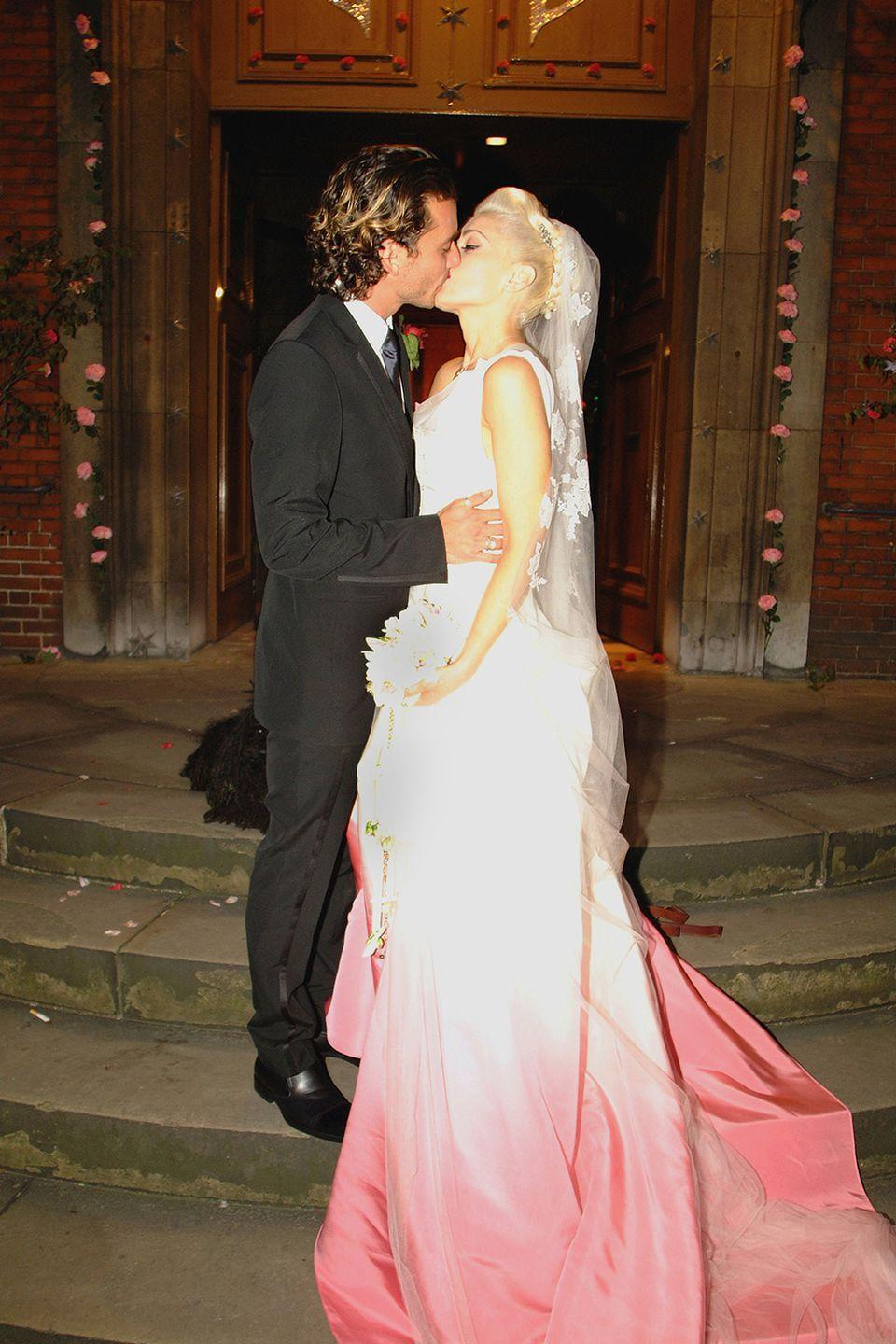 <p>The union of Gwen Stefani and Gavin Rossdale made everyone's '90s alt-rock dreams come true. Designed by John Galliano for Christian Dior, her gorgeous gown was custom dip-dyed and hand-painted in pink.</p>