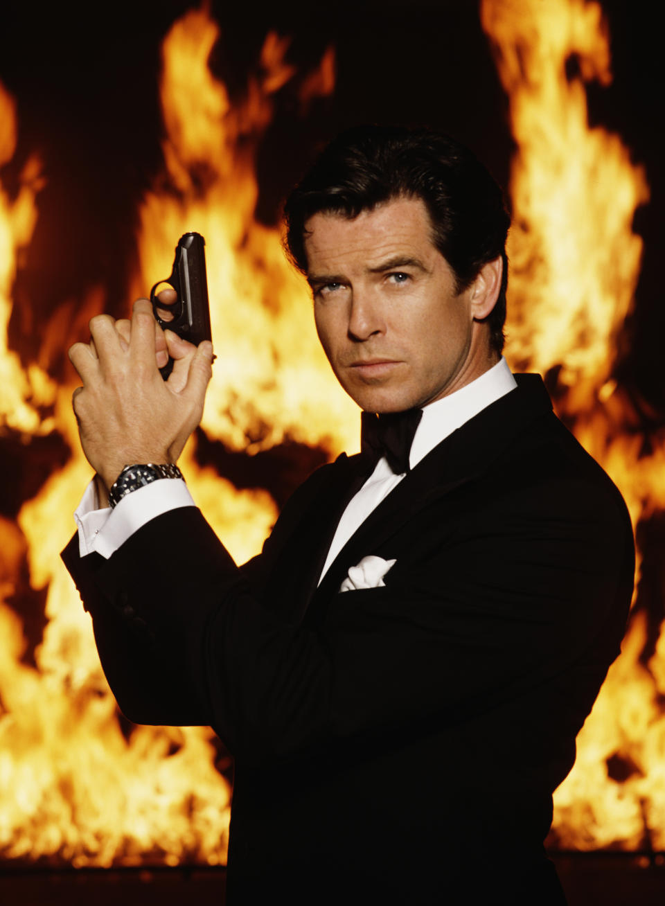 Irish actor Pierce Brosnan stars as James Bond in the film 'GoldenEye', 1995. He is holding his iconic Walther PPK. (Photo by Keith Hamshere/Getty Images)