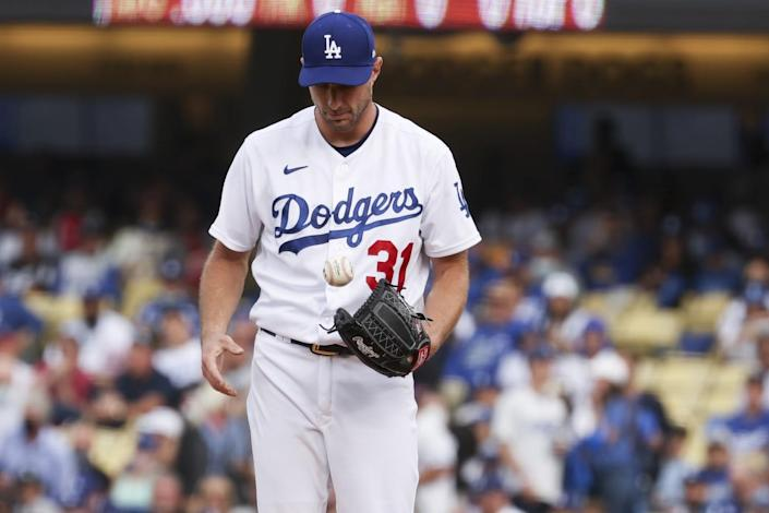 Los Angeles Dodgers starting pitcher Max Scherzer tosses the baseball while on the mound