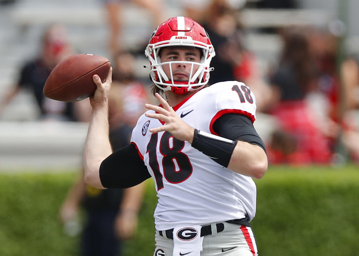 ATHENS, GA - APRIL 17: Quarterback JT Daniels #18 of the Georgia Bulldogs warms up prior to the G-Day spring game at Sanford Stadium on April 17, 2021 in Athens, Georgia. (Photo by Todd Kirkland/Getty Images)