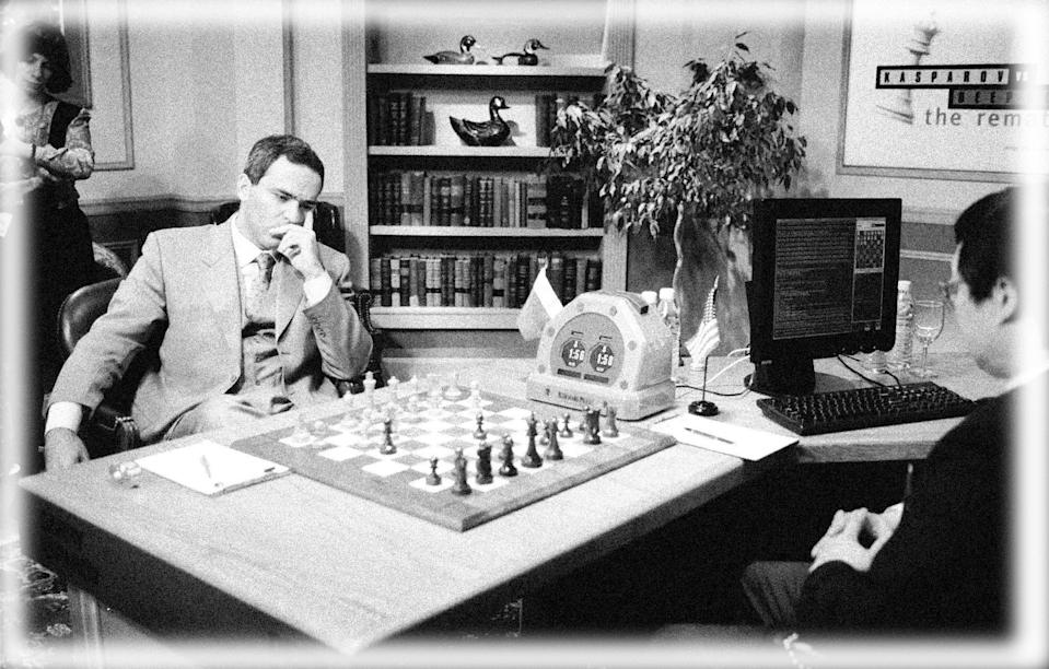 Chess Grand Master Gary Kasparov, left, comtemplates his next move against IBM's Deep Blue chess computer while Chung-Jen Tan, manager of the Deep Blue project looks on in New York, Saturday, May 3, 1997, during the first game of a six-game rematch between Kasparov and Deep Blue. The computer program made history last year by becoming  the first to beat a world chess champion, Kasparov, at a serious  game. (Photo: Adam Nadel/AP, digitally enhanced by Yahoo News)