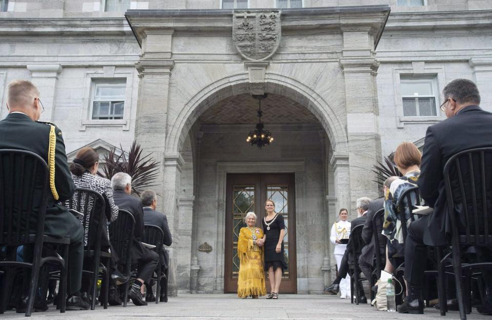 """<span class=""""caption"""">Former Gov. Gen. Julie Payette invests Jeanette Corbiere Lavell, from Wikwemikong First Nation, Ont., as a Member of the Order of Canada outside Rideau Hall in Ottawa in September 2018.</span> <span class=""""attribution""""><span class=""""source"""">THE CANADIAN PRESS/Adrian Wyld</span></span>"""