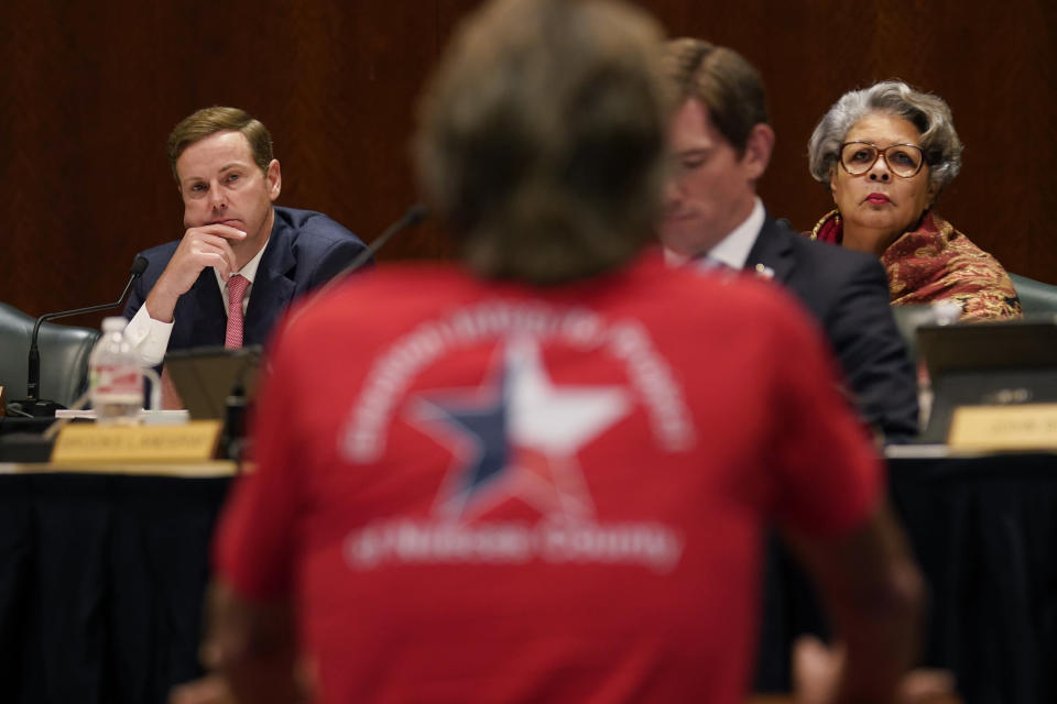 Texas State Rep. Trent Ashby, R-Lufkin, left, and Rep. Senfronia Thompson, D-Houston, right, listen to testimony during a hearing over an election bill at the Texas Capitol in Austin, Texas, Monday, Aug. 23, 2021. (AP Photo/Eric Gay)