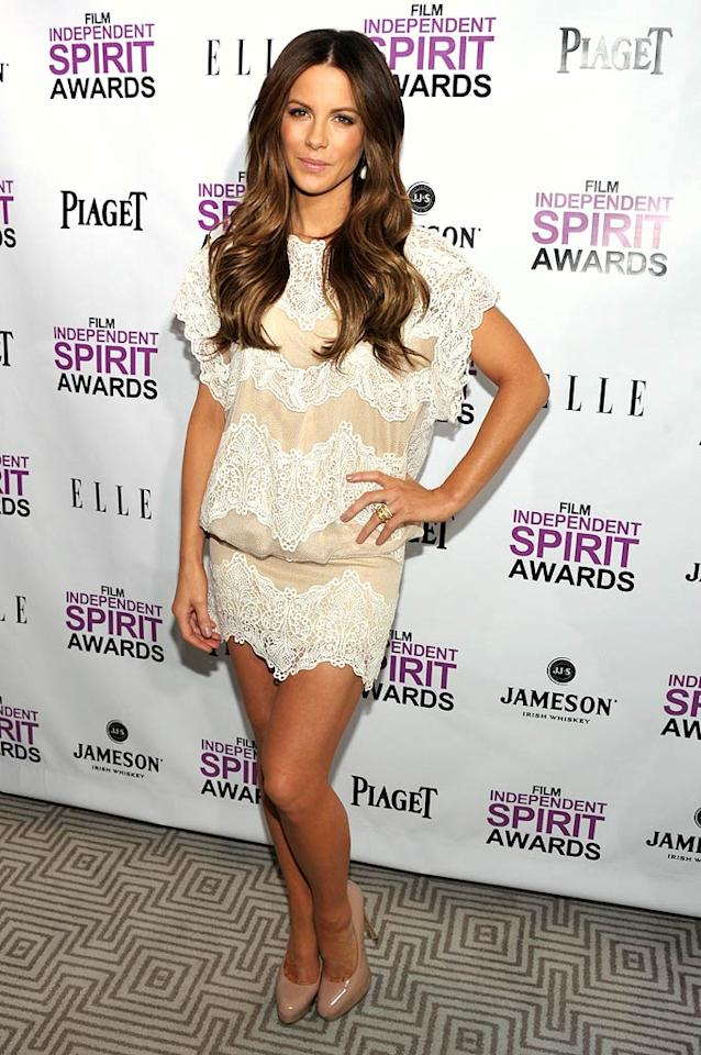 If you've got it, flaunt it! And that's exactly what British actress Kate Beckinsale did when she donned this super short, lace-adorned Tadashi Shoji number to a Film Independent Spirit Awards nominations press conference in West Hollywood, California, on Tuesday. Super-high Brian Atwood nude pumps made the lovely lady look even leggier.