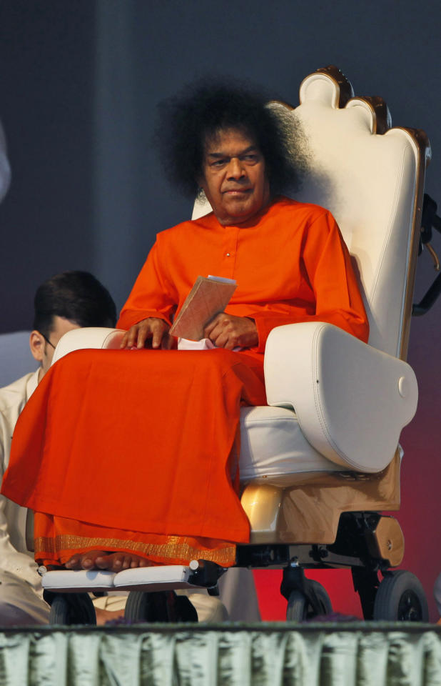 FILE - In this April 10, 2010 file photograph, Indian spiritual leader Sathya Sai Baba looks on at a function to meet his devotees in New Delhi, India. Sai Baba is hospitalized on breathing support as followers gather at his ashram in Puttaparti town in southern India.