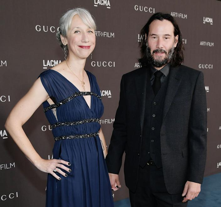 Alexandra Grant and Keanu Reeves hold hands at a Los  2019 LACMA 2019 Art + Film Gala in November. (Photo: Neilson Barnard via Getty Images)