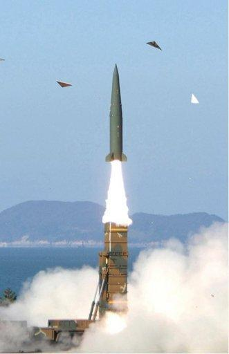 """The test-launch of a new South Korean ballistic missile at an undisclosed location, shown in a photo released by South Korea's Defence Ministry via Yonhap. North Korea demanded Thursday that South Korea apologise for what it called insults during major anniversary festivities, or face a """"sacred war"""", as Seoul unveiled the new missile to deter its neighbour"""