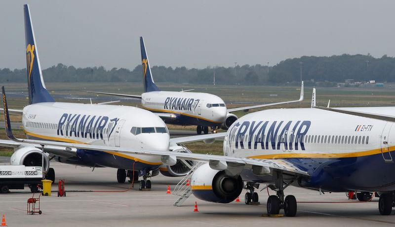 FILE PHOTO: Ryanair airplane taxis past two parked aircraft at Weeze Airport