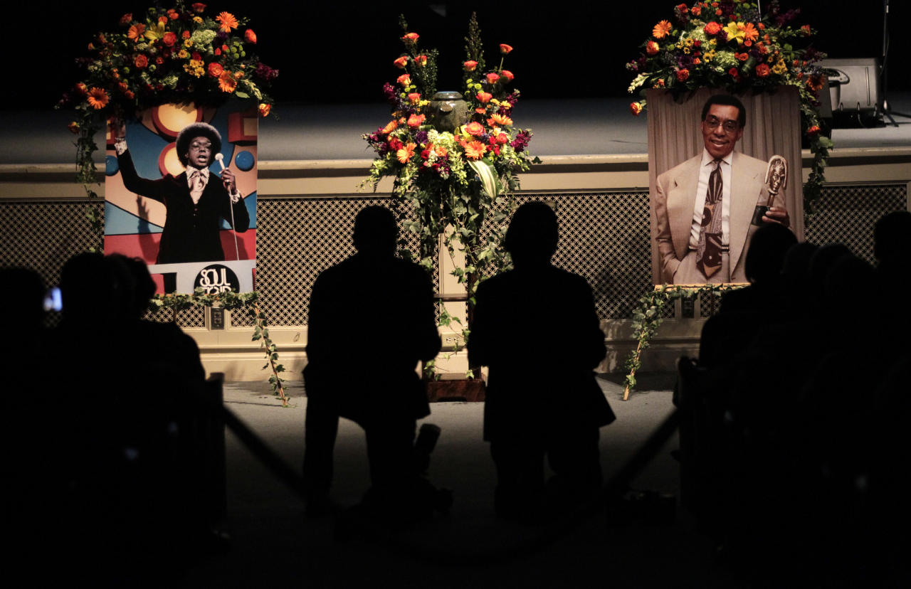 """Two photos of """"Soul Train"""" creator and host Don Cornelius are displayed during a private memorial service for Cornelius in Los Angeles, Thursday, Feb. 16, 2012. Cornelius died Feb. 1 from a self-inflicted gunshot wound. Since then, tributes to him and the show he created have been held around the country. (AP Photo/Jae C. Hong)"""