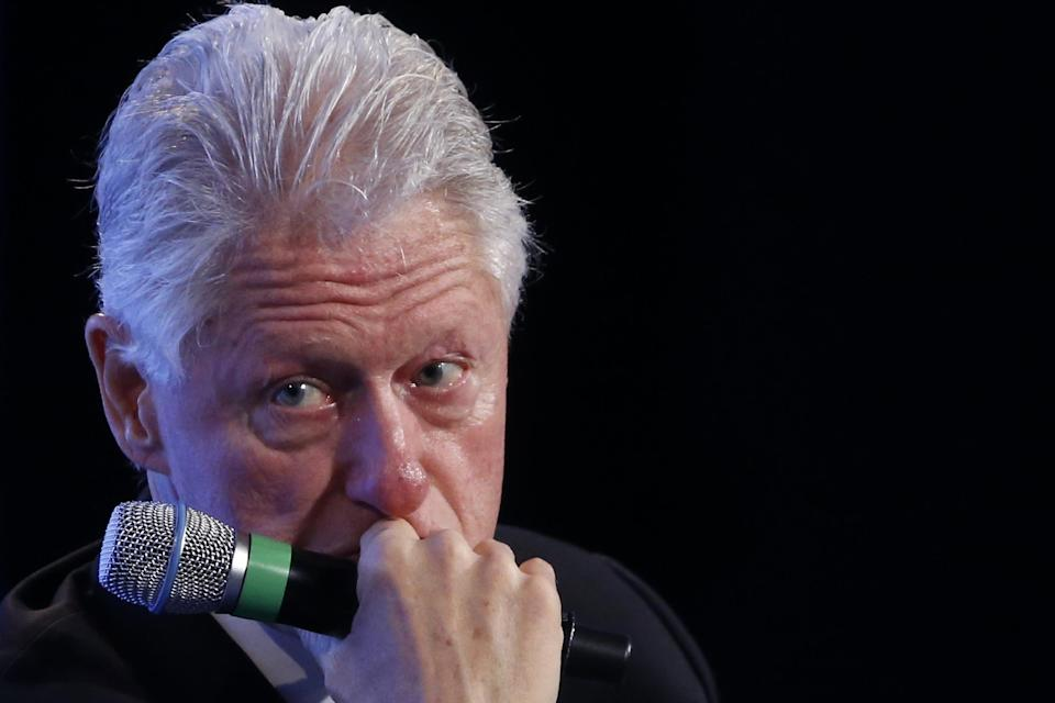 Former President Bill Clinton listens to a question from Gwen Ifill of NewsHour at the 2014 Fiscal Summit organized by the Peter G. Peterson Foundation in Washington, Wednesday, May 14, 2014. Lawmakers and policy experts discussed America's long term debt and economic future. (AP Photo)