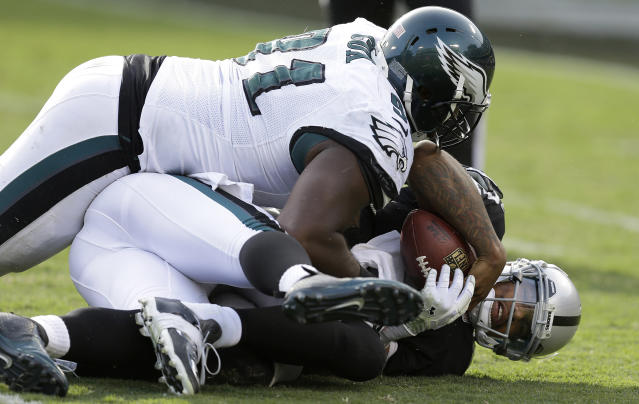 Oakland Raiders quarterback Terrelle Pryor, bottom, is sacked by Philadelphia Eagles defensive end Vinny Curry, obscured, as Philadelphia Eagles defensive end Fletcher Cox (91) lays on top during the third quarter of an NFL football game in Oakland, Calif., Sunday, Nov. 3, 2013. (AP Photo/Ben Margot)