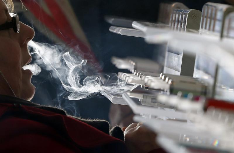 """A customer tests e-liquids for e-cigarettes during the first international fair of electronic cigarette and vapology """"Vapexpo"""" in Bordeaux, southwestern France, March 13, 2014. REUTERS/Regis Duvignau (FRANCE - Tags: BUSINESS HEALTH SOCIETY)"""