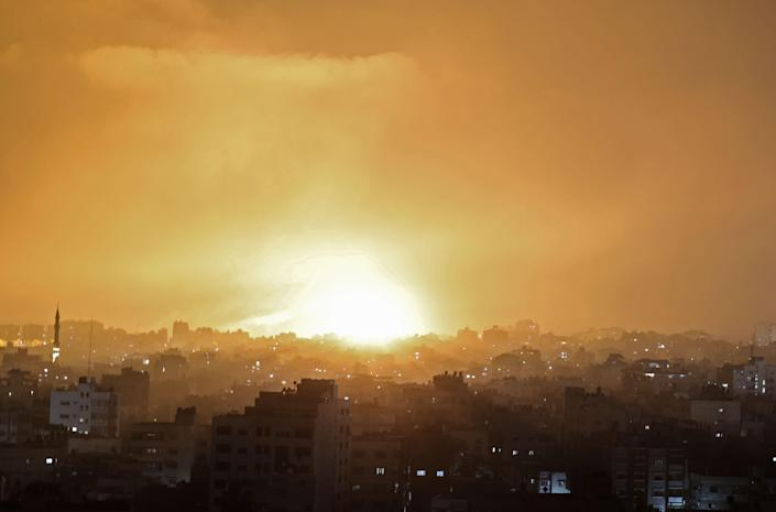 An explosion lights the sky following an Israeli air strike on Beit Lahia in the northern Gaza Strip (AFP via Getty Images)
