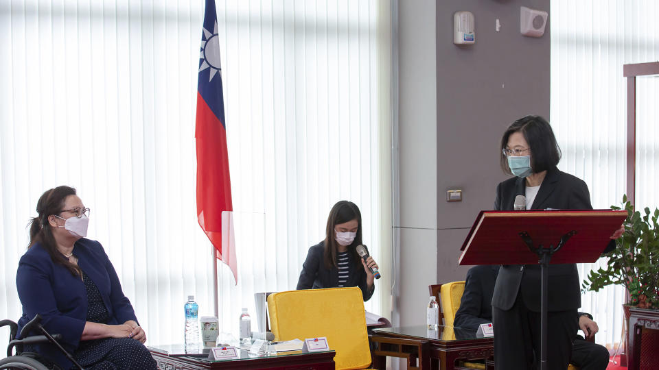 In this photo released by the Taiwan Presidential Office, President Tsai Ing-wen at right speaks near U.S. Democratic Sen. Tammy Duckworth of Illinois in Taipei, Taiwan on Sunday, June 6, 2021. The U.S. will give Taiwan 750,000 doses of COVID-19 vaccine, part of President Joe Biden's move to share tens of millions of jabs globally, three American senators said Sunday, after the self-ruled island complained that China is hindering its efforts to secure vaccines as it battles an outbreak. (Taiwan Presidential Office via AP)
