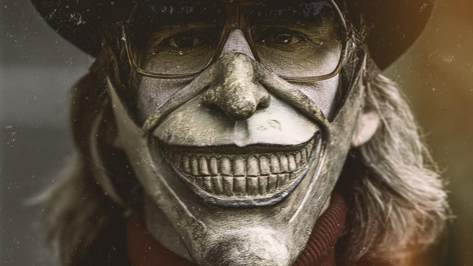 image of ethan hawke wearing a white mask with large teeth in the black phone film