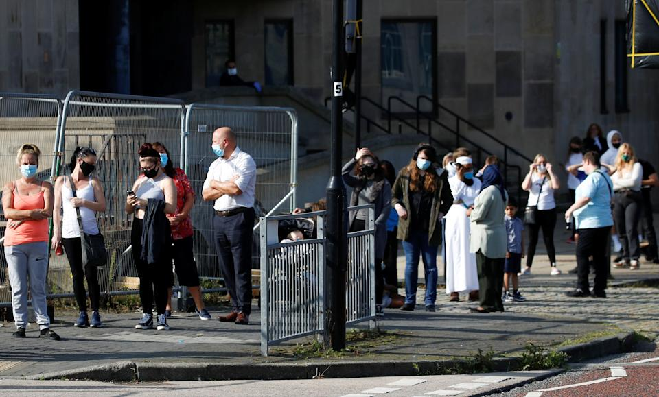 People queue outside a test center to take a coronavirus test in Bolton, in the northwest of England, Sept. 17.At more than 40,000, the U.K.'s COVID-19 death toll is the highest in Europe. (Photo: Phil Noble / reuters)