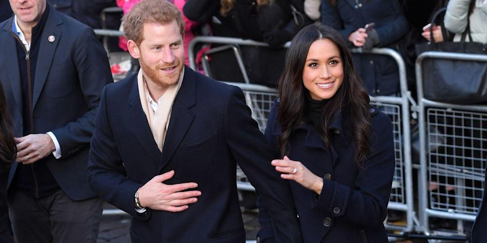 """<p>Another adorable outtake from the event, Harry held onto his fiancé's hand as they crossed the street. Making the sweet moment even better, we were treated to a full view of <a href=""""https://www.harpersbazaar.com/celebrity/latest/a13935638/meghan-markle-engagement-ring/"""" rel=""""nofollow noopener"""" target=""""_blank"""" data-ylk=""""slk:Markle's glorious engagement ring"""" class=""""link rapid-noclick-resp"""">Markle's glorious engagement ring</a> from this angle.</p>"""