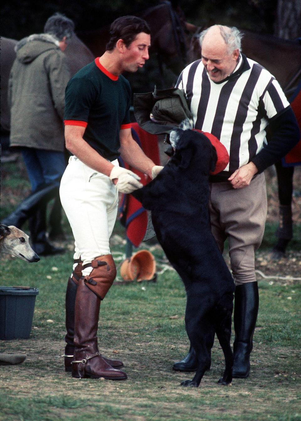 <p>Prince Charles bonds with a new four-legged friend during a polo match at the Guards Polo Ground.</p>
