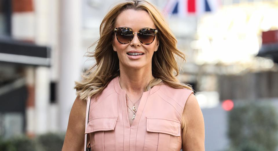 Amanda Holden packed on the glam as she made her way to Global studios this week to co-host her morning segment on Heart Radio.  (Getty Images)