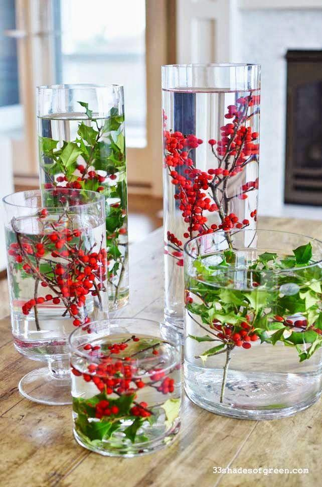 "<p>These lovely clear vases show off gorgeous holly leaves and berries, and they're so simple to make! They work well anywhere you need a splash of color from centerpieces for the guests' seating areas to the buffet table. Mix and match vase shapes for extra style points.</p><p><strong>See more at <a href=""http://www.33shadesofgreen.com/2014/11/easy-holiday-centerpieces.html"" rel=""nofollow noopener"" target=""_blank"" data-ylk=""slk:33 Shades of Green"" class=""link rapid-noclick-resp"">33 Shades of Green</a>.</strong></p>"