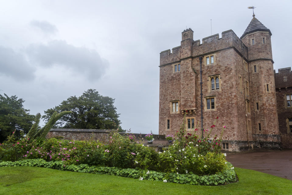 Dunster Castle is a former motte and bailey castle, now a country house, in the village of Dunster, Somerset, England UK
