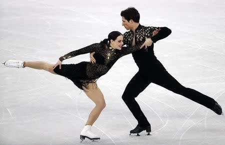 Figure Skating - Pyeongchang 2018 Winter Olympics - Ice Dance short dance competition - Gangneung Ice Arena - Gangneung, South Korea - February 19, 2018 - Tessa Virtue and Scott Moir of Canada perform. REUTERS/Damir Sagolj